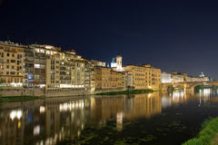 River Arno at night. Night photo of the buildings along the River Arno Stock Images