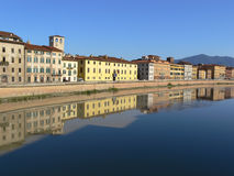 River Arno, Pisa, Italy. Beautiful reflections on the Arno river, Pisa, Italy royalty free stock image