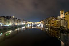 River Arno and Ponte Vecchio night view in Florence Stock Photos