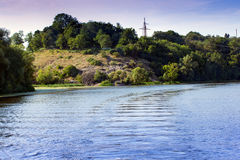 River around coastline of hills with green trees Royalty Free Stock Photos