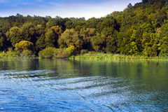 The river aroundl coastline of hills with green trees Stock Photo