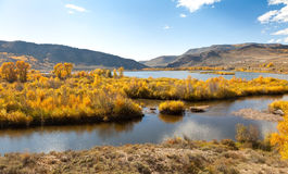 River, Aspen Trees And Mountains In Autumn Royalty Free Stock Photo