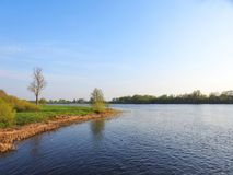 River Atmata and beautiful trees in spring, Lithuania Stock Images