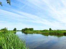 River Aukstumala and beautiful cloudy sky, Lithuania Stock Photo