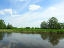 River, trees and beautiful cloudy sky, Lithuania Stock Photography