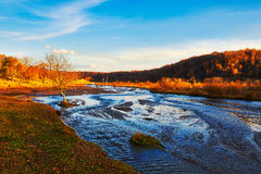 The river and autumn forest sunset Royalty Free Stock Photo