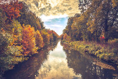 The river in autumn. Autumn landscape, river and colorful leaves on the trees Stock Image
