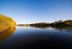 River in autumn park on sunny day Royalty Free Stock Photography