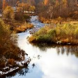 River and autumn trees Stock Image