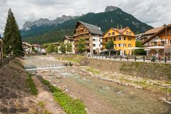 River Avisio in the historic center of Moena, the fairy of the Dolomites stock image