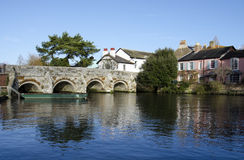 The River Avon at Christchurch in Dorset. The river Avon flows between cottages at Christchurch in Dorset Royalty Free Stock Images