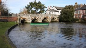 River Avon Christchurch Dorset England UK with bridge and water flowing towards the camera near to Bournemouth stock video footage