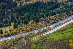 River Avvisio in Trentino-Alto Adige. River Avvisio in Cavalese, aerial view, overcast moody autumnal day, focus on water royalty free stock image