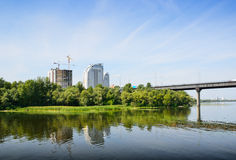 River bank of Kiev with the modern construction Royalty Free Stock Photography