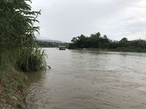 River bank Peruvian. Evening cloudy, to the distance is observed a raft Stock Photography