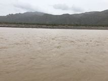 River bank Peruvian. River bank on a rainy day. Mountains are observed Royalty Free Stock Images