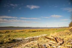 snowy river bank stock photos