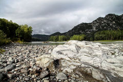 On the river Bank. Rocks on the river Bank Stock Images