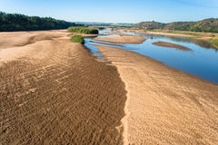 River Bank Sands Low Air Photo. Air Photo image overlooking a large river with its sand banks,going towards distant bridge .Color photo image captured from Royalty Free Stock Photography
