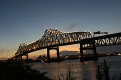 View from Baton Rouge of sunset at Interstate 10 crossing the Mississippi River in Baton Rouge stock photos