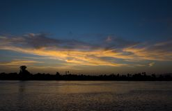 River bank silhouette at dusk sunset Royalty Free Stock Photo