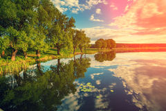 River bank at sunset Royalty Free Stock Images
