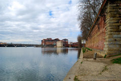 River bank in Toulouse. River bank in Tolouse in winter with red brick wall stock photo