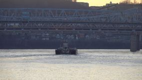 River barge boat on the Ohio River. A river barge slowly navigates down the Ohio River on a winter day stock video