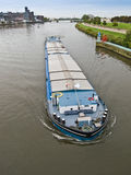River barge with cargo. Big barge on Maas river in Netherlands Royalty Free Stock Photography
