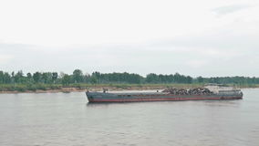 River barge loaded with garbage stock video footage