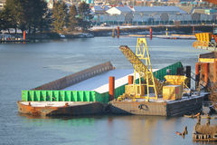 River Barge and Loading Platform Stock Images