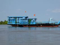 A river barge in the Mekong river delta Stock Photo