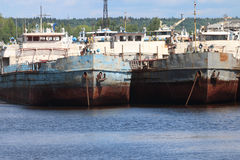 River bay with rusty cargo ships Royalty Free Stock Images