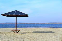 River Beach in anticipation of the new season. Beach umbrella on the sand river Stock Photo