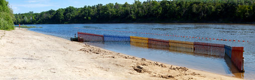 River beach fencing swimming area. Stock Photography