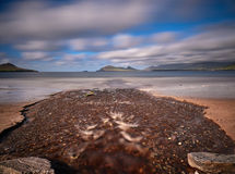 River at the beach. After a heavy downpour little rivers appear at the Dingle beaches Royalty Free Stock Image
