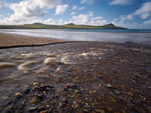 River at the beach. After a heavy downpour little rivers appear at the Dingle beaches royalty free stock photo