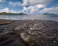 River at the beach. After a heavy downpour little rivers appear at the Dingle beaches Stock Photo
