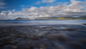 River at the beach. After a heavy downpour little rivers appear at the Dingle beaches Stock Photos