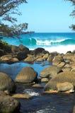 River & Beach in Kauai, Hawaii. A river flows into a tropical beach in Kauai, Hawaii Stock Photography
