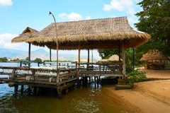 River beach with straw hut in Kampot Cambodia royalty free stock photo