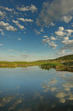 River. Beautiful clouds reflected in the water a summer day Stock Image