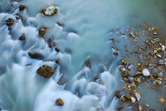 River Bed. Aerial view of the water flowing through some stones in the Dolomites, Italy Royalty Free Stock Photo