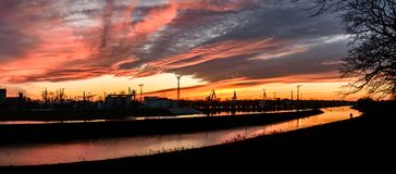 The river bed in the coal unloading zone at the thermal power plant, sunset. Poland, The river bed in the coal unloading zone at the thermal power plant, sunset royalty free stock photo