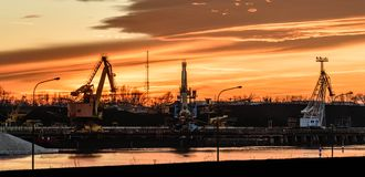 The river bed in the coal unloading zone at the thermal power plant, sunset. Poland, The river bed in the coal unloading zone at the thermal power plant, sunset stock image