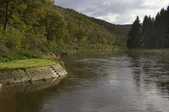 River bend autumn. Bend in the river semois at autumn time stock image