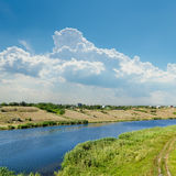 River and blue cloudy sky Stock Images