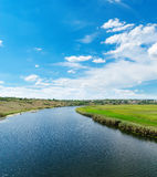 River and blue cloudy sky Royalty Free Stock Images