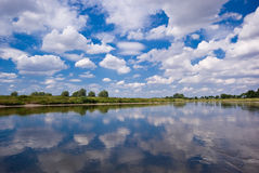 River and a blue sky. On this picture you can see a river and a blue sky Royalty Free Stock Photos