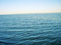 River and blue sky separated by a horizon line Royalty Free Stock Image